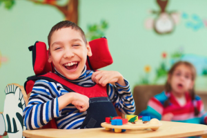 Boy in wheelchair playing with blocks